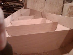 Canoe build project - All the planks stitched together