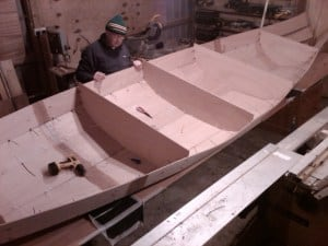 canoe building. Seat supports being stitched in place